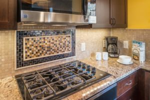 Kitchen Remodeling - custom tile background Rhode Island luxury home build