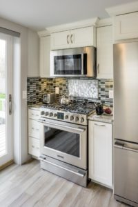 Kitchen Remodeling - Stove countertop with tile backsplash in luxury Rhode Island home