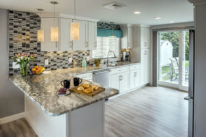 Custom sliding door off kitchen in luxury coastal Rhode Island home